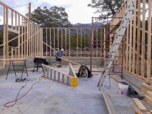 A contractor framing a new structure in the Zapata subdivision